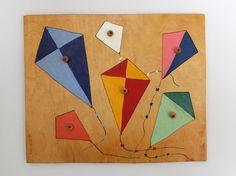 Vintage wooden peg puzzle board in kite design