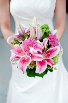 Pink wedding flowers  FAVORITE!!!!! ..... Less closed lillies.. or none.. more? missing something but DEF pink stargazer lillies !!! :)