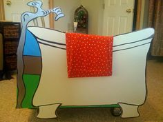JoJo's tub, Poster foam board cut out, with plastic tub on a cart. Attach the poster board to the tub with velcro