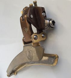 Very rare Campagnolo C Record 1 Gen front derailleur. Gold plater Gerber version. Shown in Campagnolo catalogue n18 bis in it's original factory finish. Exposed middle arm pin above the mounting bolt and horizonatally pinned cage, later versions were diagonally pinned.