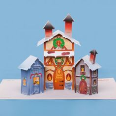 Christmas Time - Christmas Village Paper Model - by Spoonfull == An easy-to-build Christmas Village to decorate your home, by Spoonfull website. Disney Christmas Village, Christmas Village Houses, Christmas Town, Christmas Villages, Christmas Colors, Christmas Crafts, Putz Houses, Christmas Traditions, Christmas Stuff