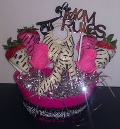 Mother's Day candy bouquet, designed with gourmet chocolate covered zebra strawberries, zebra print shoe and purse.