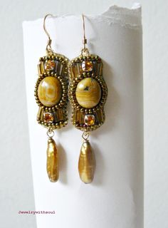 Moon world bead embroidery earrings with crazy lace agate cabochons, freshwater pearl sticks and seed beads in honey yellow brown and gold. $40.00, via Etsy.