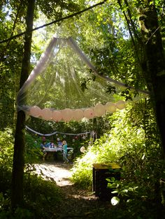 For our Fairy Party entrance in the forest, we used mosquito netting hung from the trees with a few balloons inside at the bottom