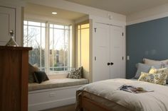 Unlike many houses that have the bedroom closets built at the interior walls, the closets in this child's bedroom flank the window so a built-in window seat can be incorporated into the room.