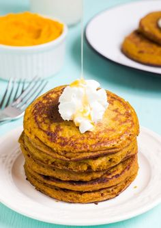 These Gluten Free Pumpkin Pancakes are melt-in-your-mouth pancakes! Light and fluffy, these gluten free pancakes take only 10 minutes to make!