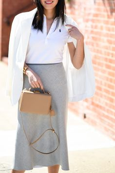 A polo shirt styled into a chic outfit by @9to5chic