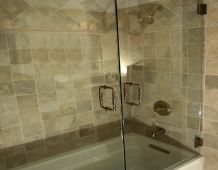 Bathroom remodel by Renovisions. Custom shower doors and tile work. http://www.renovisionsinc.com
