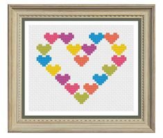 Heart cross stitch chart in a fun modern design. An easy cross stitch pattern well suited to beginners which is small enough to make your own greetings card with.  To see the other designs in my shop please go to https://www.etsy.com/uk/shop/CrossStitchRebel   • Whole cross stitches only • Stitch count 48w x 38h • Six colours • Finished dimensions width x height  10 ct aida - 12.2 x 9.7 cm /4.8 x 3.8 inches  14 ct aida - 8.7 x 6.9 cm /3.4 x 2.7 inches  18 ct...