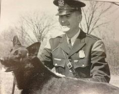 Michigan State Police -  Tpr. Richard Abbott and Jocko who formed the department's first canine team in 1960.