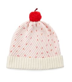 Playful Pom Poms: The bauble as a cherry on top of a cupcake beanie. neimanmarcus.com