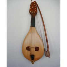 "The Gadulka is a traditional Bulgarian bowed string instrument. Alternate spellings are ""gudulka"" and ""g'dulka"". Its name comes from a root meaning ""to make noise, hum or buzz"". The gadulka is an integral part of Bulgarian traditional instrumental ensembles, commonly played in the context of dance music."
