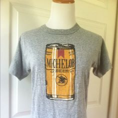 Vintage Michelob beer shirt OMG. This shirt is the jam. Vintage from the late 70's - early 80's, this soft, grey shirt has a super sweet silkscreen of a can of Michelob beer. There is no tag, but this would fit a size small to medium. My mannequin is a size 6 for reference. This shirt is in immaculate shape for it's age, no holes, rips or stains. On the fence about selling this one! Tops