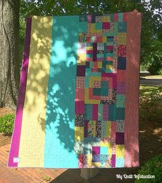 Around the World Blog Hop and Framed...love how she pieced the back of this quilt.