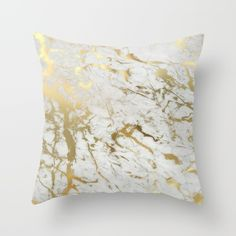 Gold marble Throw Pillow, because adding a white and gold touch to nearly everything is a must.
