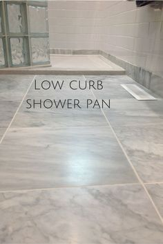 Low curb (or low profile) solid surface shower pans make a shower safer and are stylish. I like the curved walk in glass blocks as well. http://blog.innovatebuildingsolutions.com/2015/09/19/5-tips-brighten-open-guest-bathroom/