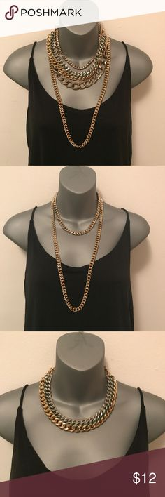 "4 chain necklace bundle (4 separate chains) 4 gold metal chain bundle: 1) plain gold metal long Cuban link chain (30"" / 15"" drop) with lobster claw clasp. 2) plain gold metal short Cuban link chain (16"" / 8"" drop) with lobster claw clasp. 3) gold & silver metal double layer Cuban link chain with green thread detail (18"" / 9"" drop) with lobster claw clasp. 4) brass metal wide Cuban link chain with thinner chain at top and beaded link detail in between (18"" / 9""!drop) with lobster claw clasp…"