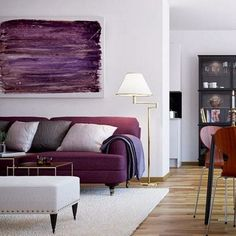 Deep tones of Orchid and purple against a neutral backdrop and natural wood.