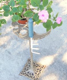 Vintage ash tray stand repurposed into plant stand!  I've had one of these in my attic for years not knowing what to do with it!