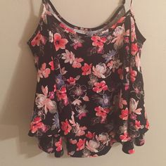 Hollister Floral Tank Top Never worn but removed tags. The material is thick and so comfy! Would be perfect for layering! Size XS! Hollister Tops Tank Tops
