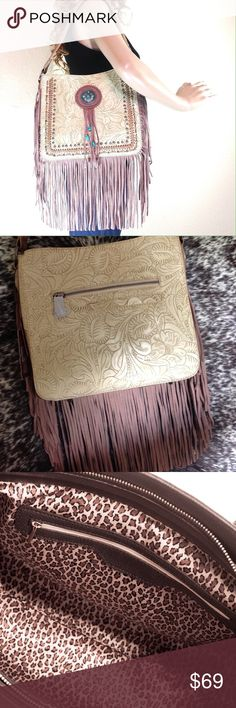 """Trinity Ranch Tooled Leather Fringe Bag NWT Brand new with tags! NWT. Trinity Ranch leather handbag with tooled floral design, fringe, and decorative concho.  Single, wide, flat shoulder strap. Inside wall zip and slip pockets. 11 X 10 X 4"""".  Strap drop 9.5"""".              🔹Please ask all your questions before you purchase! I am happy to help! 🔹Sorry, no trades or holds. 💕Happy Poshing! Trinity Ranch Bags Shoulder Bags"""