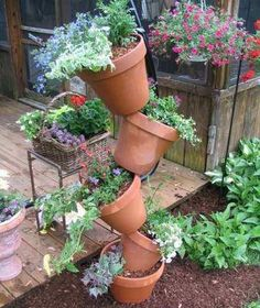 TIPSY POTS  isn't this a real space saver! I could see this as an herb 'garden'--even on a back porch rooted in a large pot/planter with rocks to weigh it down and smaller pots for herbs.