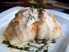 Crab-Stuffed Flounder & Champagne Cream Sauce... Perfect for a special occasion #seafoodrecipes