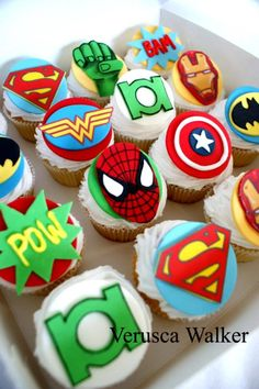 Super Hero Cupcakes by Verusca Walker pretty sure Sharee and I could pull these off for derek's bday. Way easier than that cake!!!! Lol