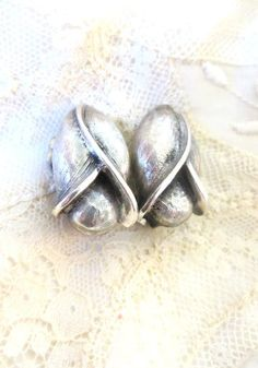 Tortolani designer flower vintage clip on earrings silver tone spring accent signed by 2shoppingdiva on Etsy