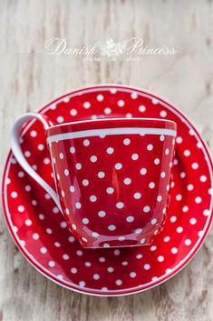 Cheerful red and white polka dot cup and saucer.