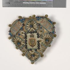 A First World War period 'sweetheart' pin cushion that was possibly commercially produced as a kit for convalescing and disabled soldiers as well as civilians. Creative Textiles, Fabric Beads, Vintage Valentines, Heart Art, Valentine Heart, Beaded Embroidery, Embroidery Ideas, Pin Cushions, Vintage Sewing