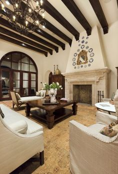 spanish style living room with beams -- I love the beams!!!