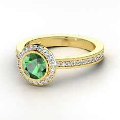 Love it, would like yellow gold band, white gold top so that diamonds around emerald stand out more