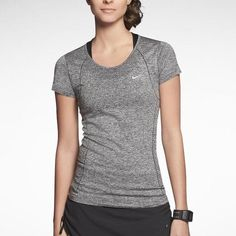 Women's Nike Dri-Fit Knit Short Sleeve Seamlessly constructed with nylon and polyester yarns for a lightweight, comfortable feel. Whether you're out for a run or at sports practice, the Nike Dri-FIT Knit Short-Sleeve Running Shirt is essential for your active lifestyle. Reflective elements enhance visibility in low light. It'll make you stand out.    ✈️ Ship within 24hrs  No Trades/No PayPal/Mercari ✅ Use Offer Feature to Negotiate Nike Tops Tees - Short Sleeve