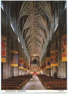 The nave and banners, Winchester Cathedral, Hampshire by Alwyn Ladell, via Flickr