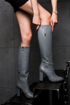 Leather high heeled boots on skinny legs by Yarose Shulzhenko