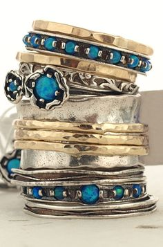 Stacked turquoise and gold bracelets