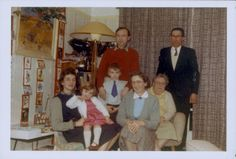 Printed colour photograph of Ron and Monica H with their relatives in the sitting room at 33 Woodville Gardens, Ruislip, Middlesex. The photograph was possibly taken by Monica H's brother-in-law at Christmas in 1962. This is a copy of the original photograph made for the Geffrye Museum in January 2010, and is one item in the Documenting Homes collection (156/2011-1 to –40) from Ron H.