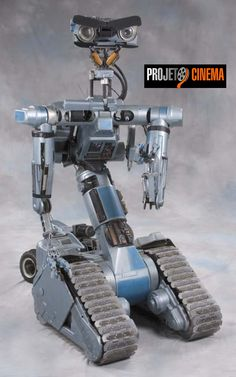 Johnny 5 is alive. Hey booger lips, your momma's a snowblower! Great movie from the '80s!