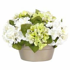 """Create a lush tablescape or charming vignette with this lovely faux hydrangea arrangement, nestled in a clay pot for classic appeal.  Product: Faux floral arrangementConstruction Material: Polyester, plastic, natural moss, foam and clayColor: GreenFeatures: Includes faux hydrangeaDimensions: 10"""" H x 13"""" DiameterCleaning and Care: Wipe with dry duster"""