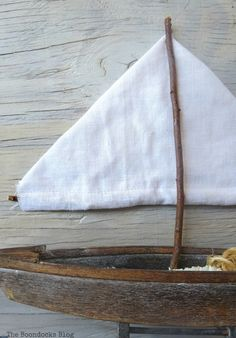 The sailboat made from junk in a dresser drawer, Seaside Art from a hidden treasure in the dresser / theboondocksblog.com