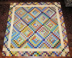 "Gorgeous quilt made with ""scrappy trip around the world"" blocks. LOVE the border."