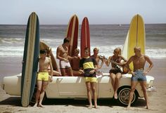 Ford mustang on beach with surfboards1964