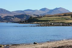 An Teallach mountain ridge from Laide beach on the nc500 route, West coast of Scottish Highlands