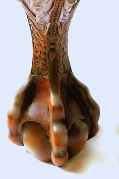 claw foot--actually called ball and claw.  One of the antique feet on furniture that my father loved.:
