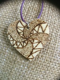 A personal favourite from my Etsy shop https://www.etsy.com/uk/listing/525955336/zentangle-wooden-heart-shaped-pendant