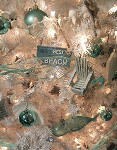 """""""White Christmas trees can remind us of a beautiful wintry landscape or of the white seafoam on ocean waves. So take a look at these magical white coastal beach Christmas trees -you might ditch green after seeing these! Beach Christmas Trees, Coastal Christmas Decor, Nautical Christmas, Tropical Christmas, Winter Christmas, Christmas Holidays, Christmas Crafts, Christmas Bulbs, Christmas Decorations"""