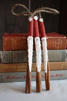 cinnamon stick santa ornaments. prob smell great hanging on the tree :)