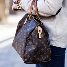 LV Vintage Speedy Monogram 30 Gorgeous Speedy 30. 100% authentic! Serial # is shown in pics. Comes with padlock and key. No dustbag, I had it stored in a pillow case. Flaws: there's a patch seen inside the bag because there was a rip and was fixed by a non-Vuitton shop. Small stains inside, bit of storage smell) but not much, small crack on top(hardly noticeable), no rips or stains outside. Edges are shown in pic, you can see wear on the edges but no piping coming out. Absolutely beautiful…