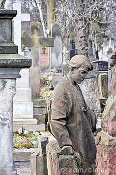cemetery art in Poland | An 19th century antique art on cemetery in Warsaw. Poland.